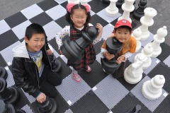 The annual Middlesbrough Mela was held in it's new home of Centre Square in the town centre on Sunday afternoon with a great mix of food, fun, dance and singing.L2R Zhi Peng Guo, Shi Yu Guo and Zhong Ze Guo play on the giant chess board.
